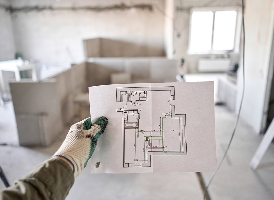 contractor holding a floor plan